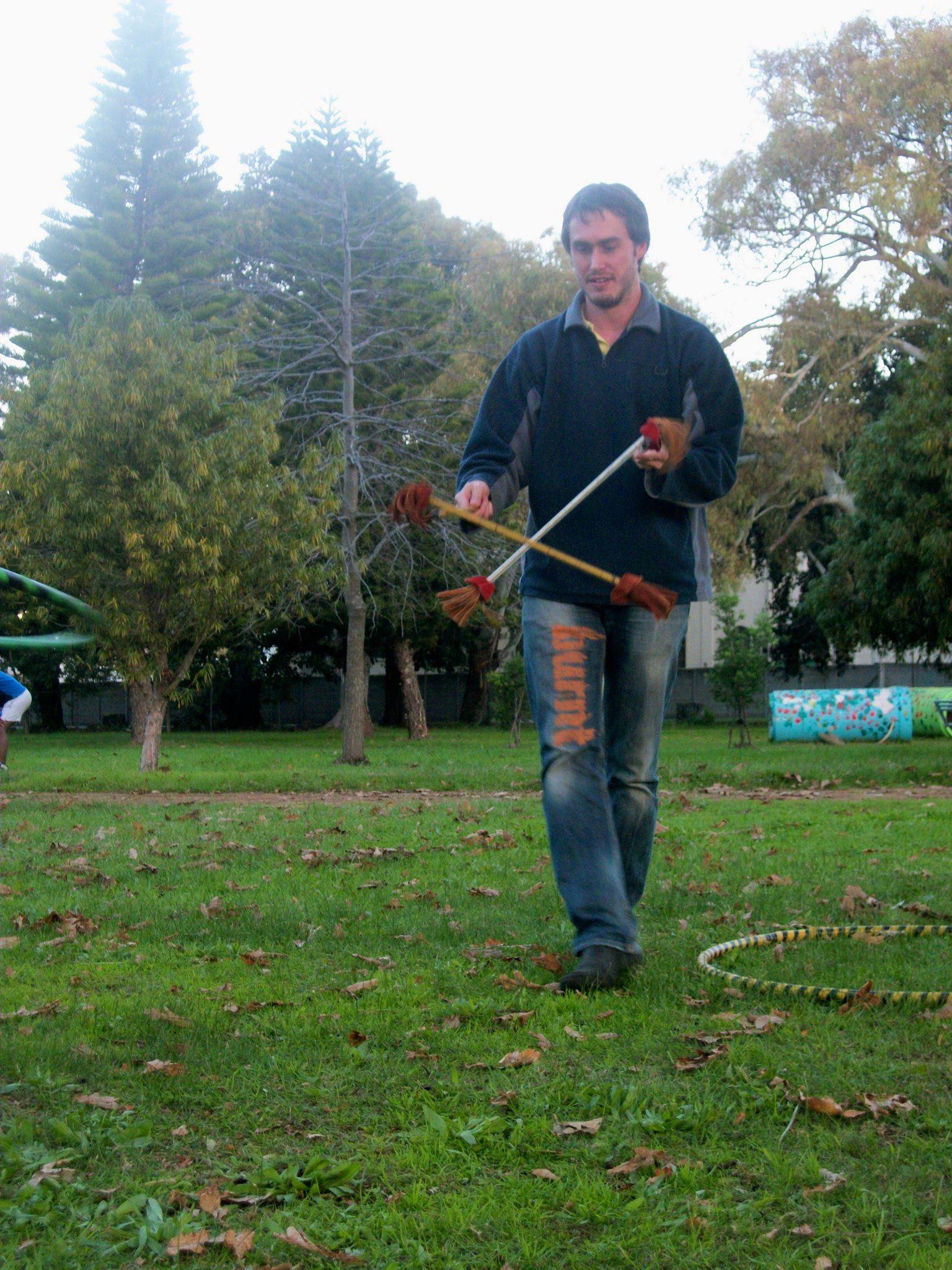 Duncan Greenwood spinning flower sticks in 2012