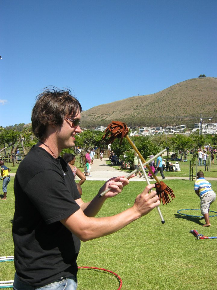 Duncan Greenwood spinning flower sticks in 2012