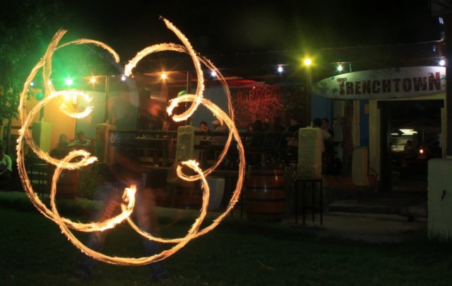 Duncan Greenwood performing in-spin flower patterns with fire flower sticks - slow shutter photography. - Flow DNA